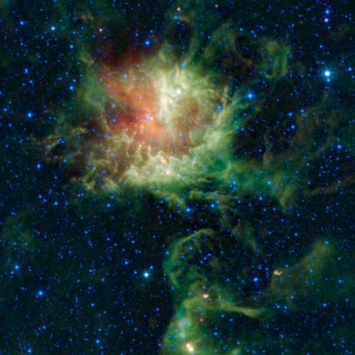 """Oct. 26, 2011: In visible light, the star-forming cloud catalogued as NGC 281 in the constellation of Cassiopeia appears to be chomping through the cosmos, earning it the nickname the """"Pacman"""" nebula after the famous Pac-Man video game of the 1980s. However, the Wide-field Infrared Survey Explorer, or WISE, observed the nebula in infrared light, revealing a different view."""