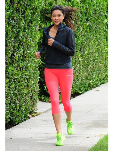 Shay Mitchell wearing under armour jacket, tank, leggings and sneakers. Love adding color to my workout clothes!   www.annywallace.com