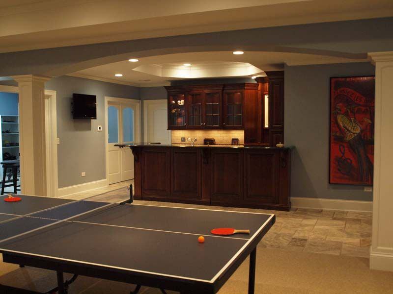 Award winning basement remodel features game area bar for Finished basement designs
