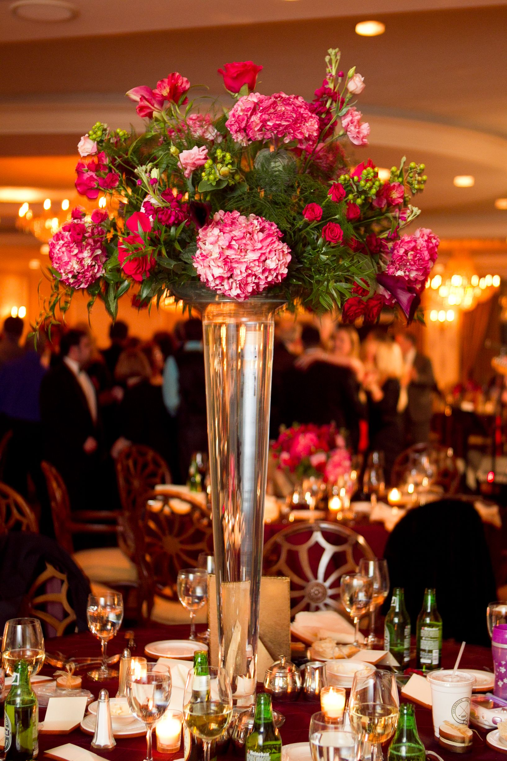 Carithers Trumpet Vase Topped With Hydrangea Berries And Roses At