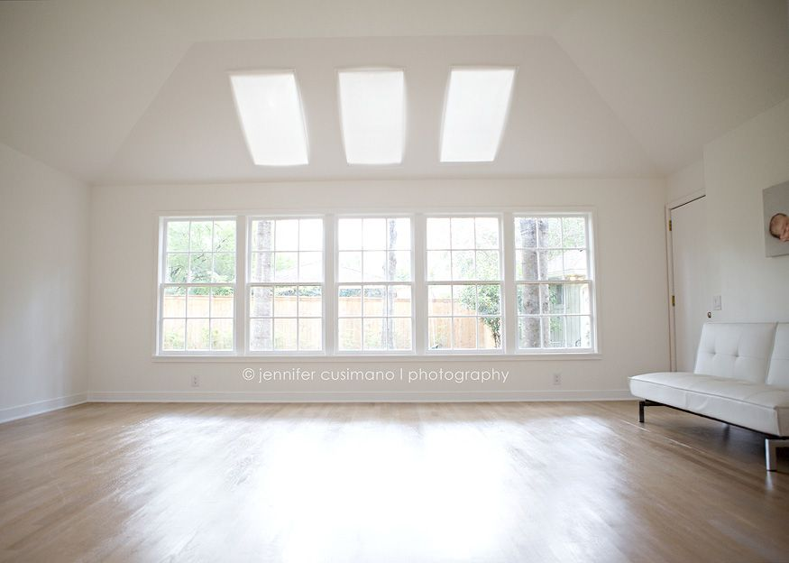 Natural Light Studio With Wood Floor And Sky Lights