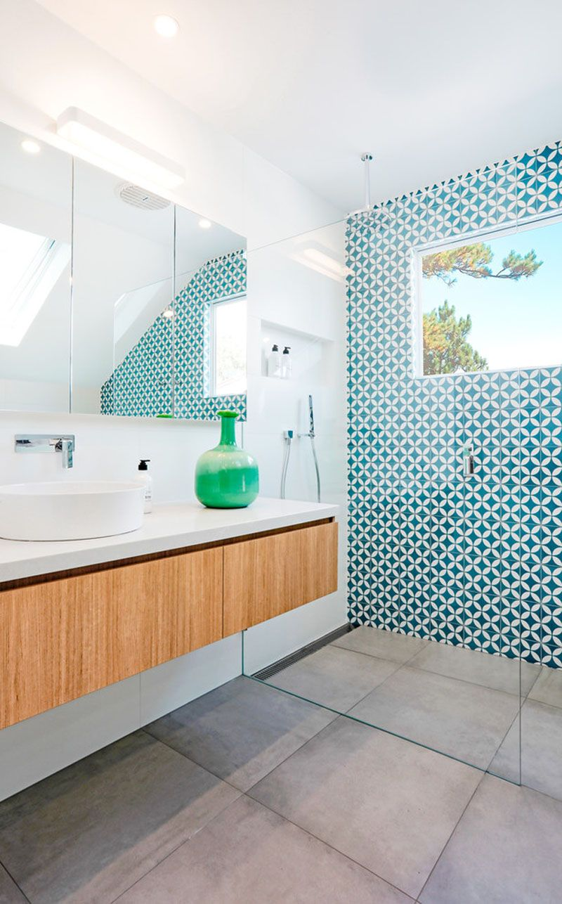 This White And Wood Bathroom Has A Bright Blue Accent Wall To Liven It Up Glamorous Bathroom Decor Blue Bathroom Accessories Blue Bathroom Decor