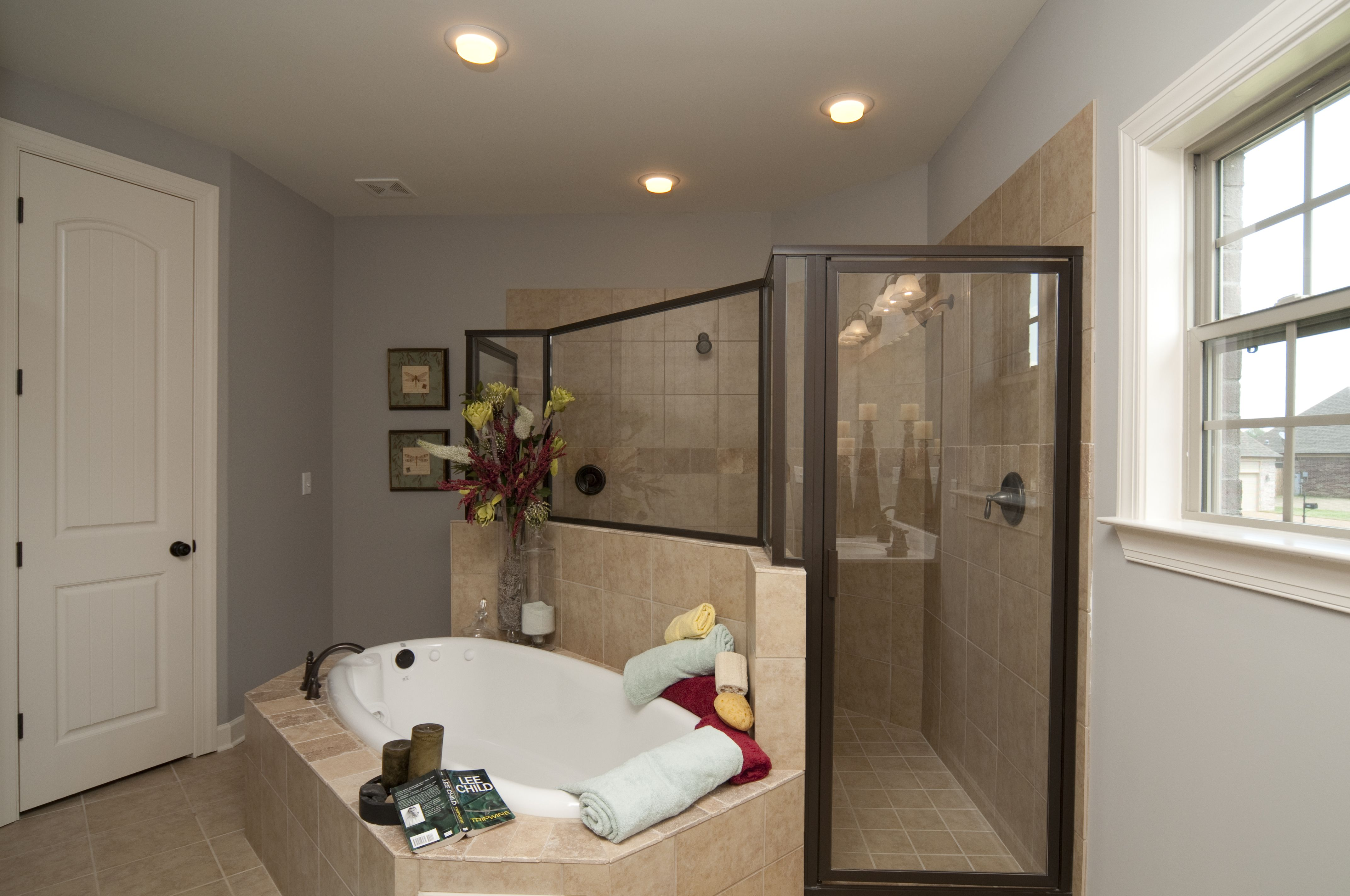 Master bedroom with jacuzzi tub  Walk thru Double Shower This is what we are getting in the Master