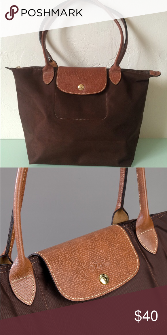 Large Longchamp Le Pliage Tote Bag Brown ✨ % authentic classic Longchamp Le Pliage large tote bag in chocolate brown. Purchased at the Longchamp store in Paris. Used with some minor signs of wear on the bottom (see pictures) but overall in very good condition. It folds and has a snap on the back. Dimensions 12x11x7.5 inches. Real leather handles and fixtures. Great everyday bag or for carrying books and a laptop to classes. Longchamp Bags Totes