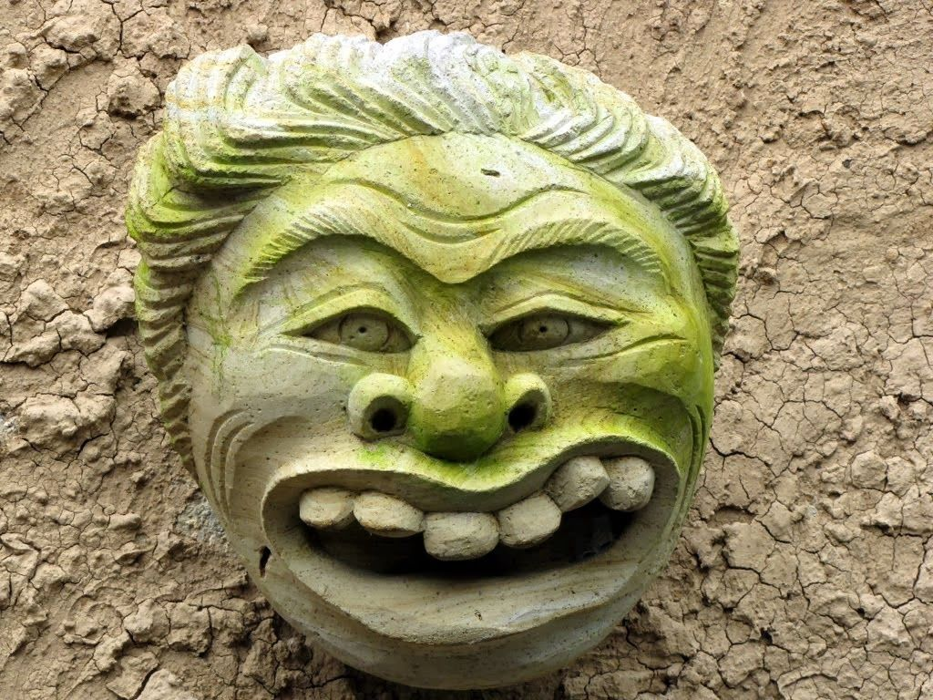 Faces of Bali: Ugly carved stone heads are often used as outdoor ...