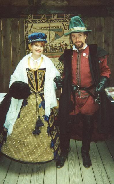 Elizabethan Lord and Lady Renaissance festival costume. The Lady's dress is based on the Seal of the Goldsmiths by Condo Blues