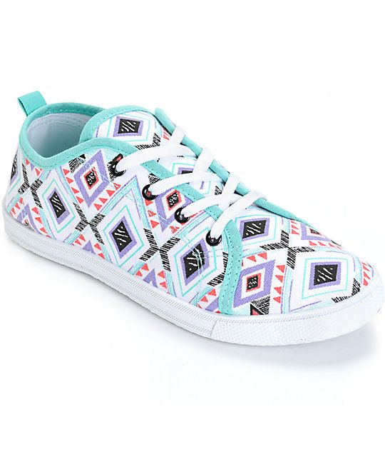 eab44d3cb6 Add some color to your casual look with these low-top shoes that are made  with a colorful tribal print canvas upper and a lightweight design for  all-day ...