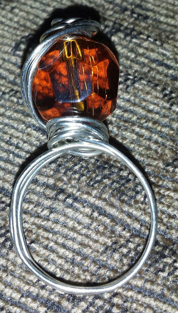 Check out this item in my Etsy shop https://www.etsy.com/listing/197572922/wire-wrapped-bead-ring