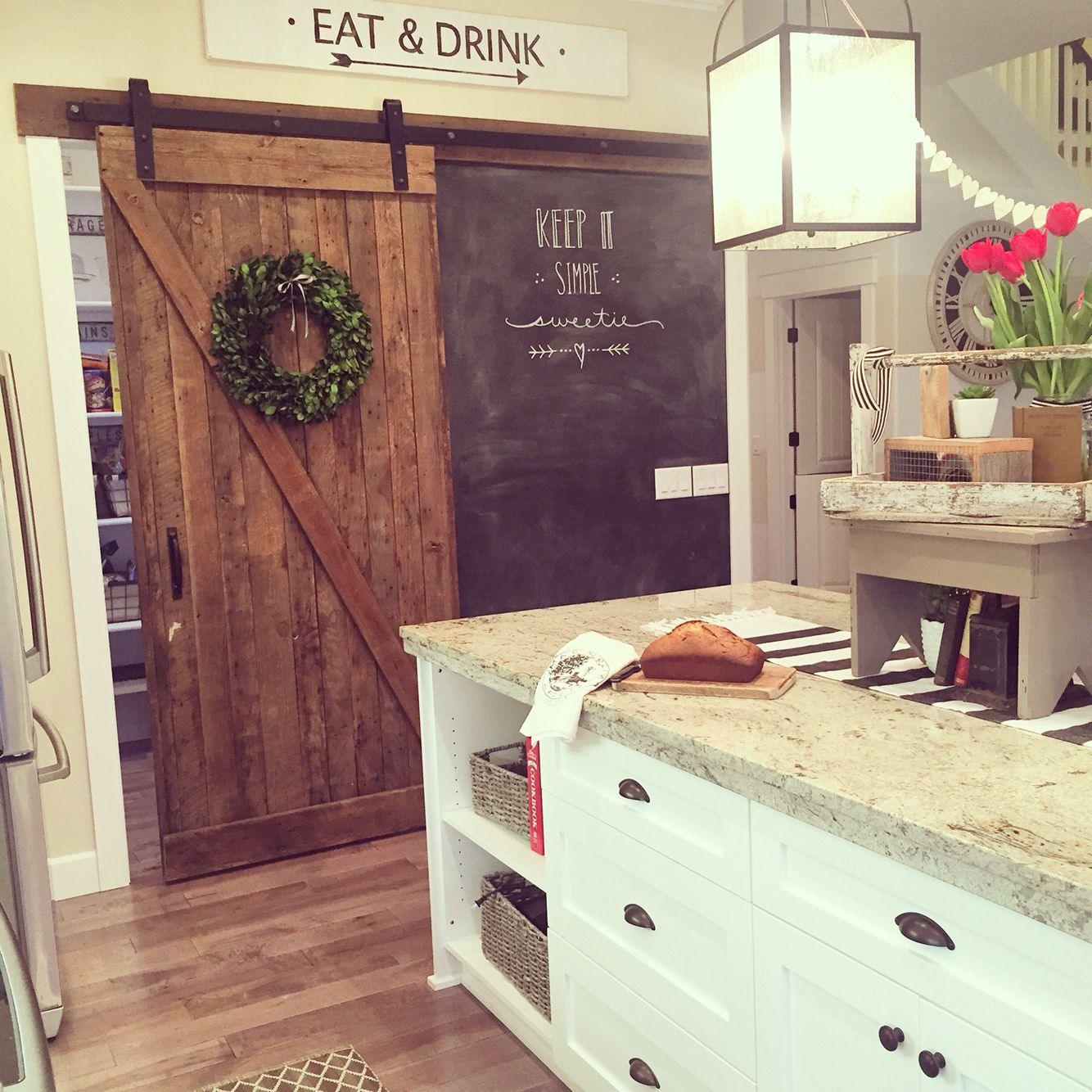 White Kitchen Cabinets Yellow Granite: A Rustic Barn Door Crafted From Salvaged Barn Wood Is A