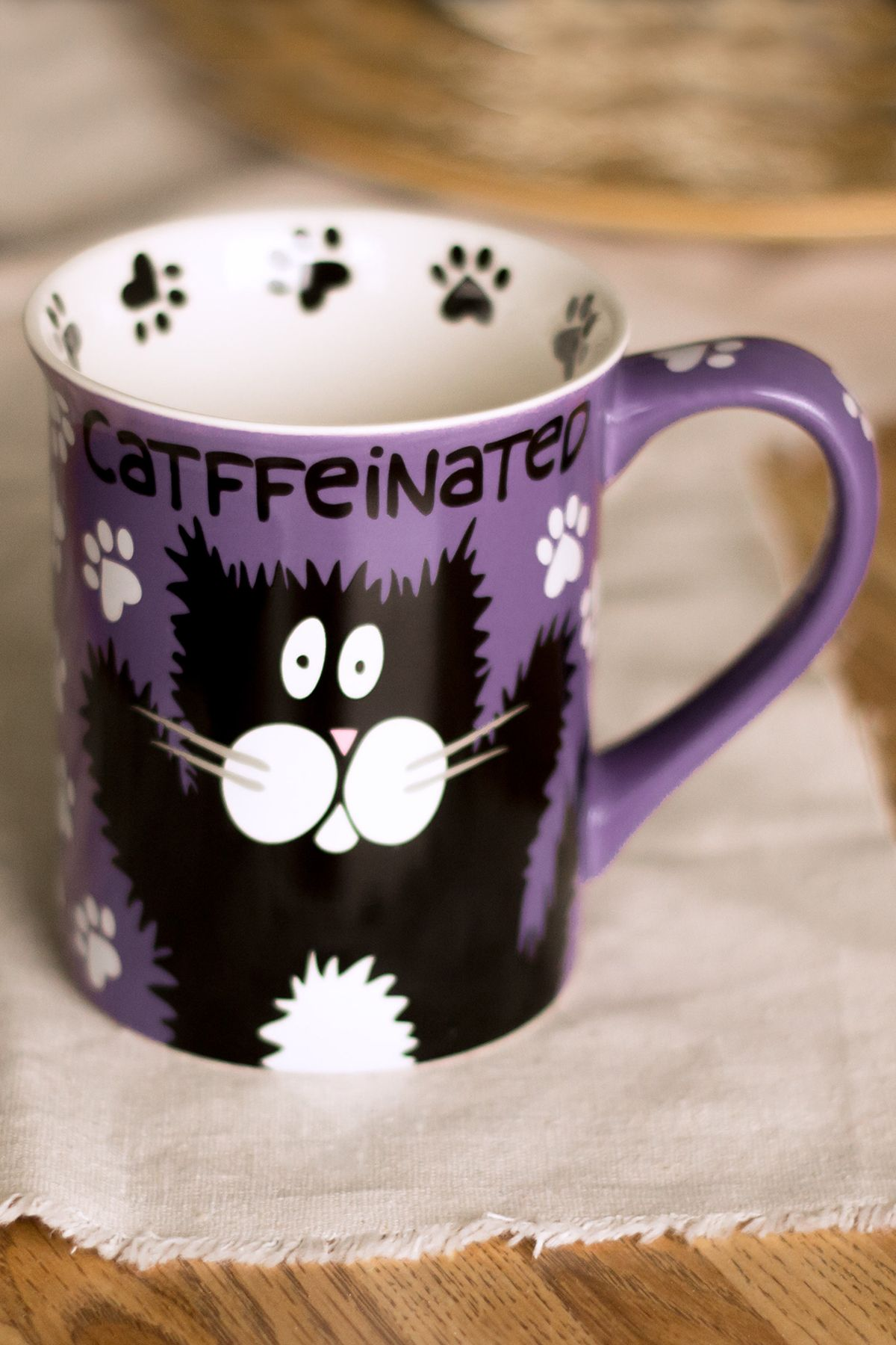 Whether you take your coffee catffeinated or decatf, our roomy mug expresses your preference in comic style. One side shows a wired-up kitty enjoying a coffee buzz while the other shows her curled up for a cozy nap.
