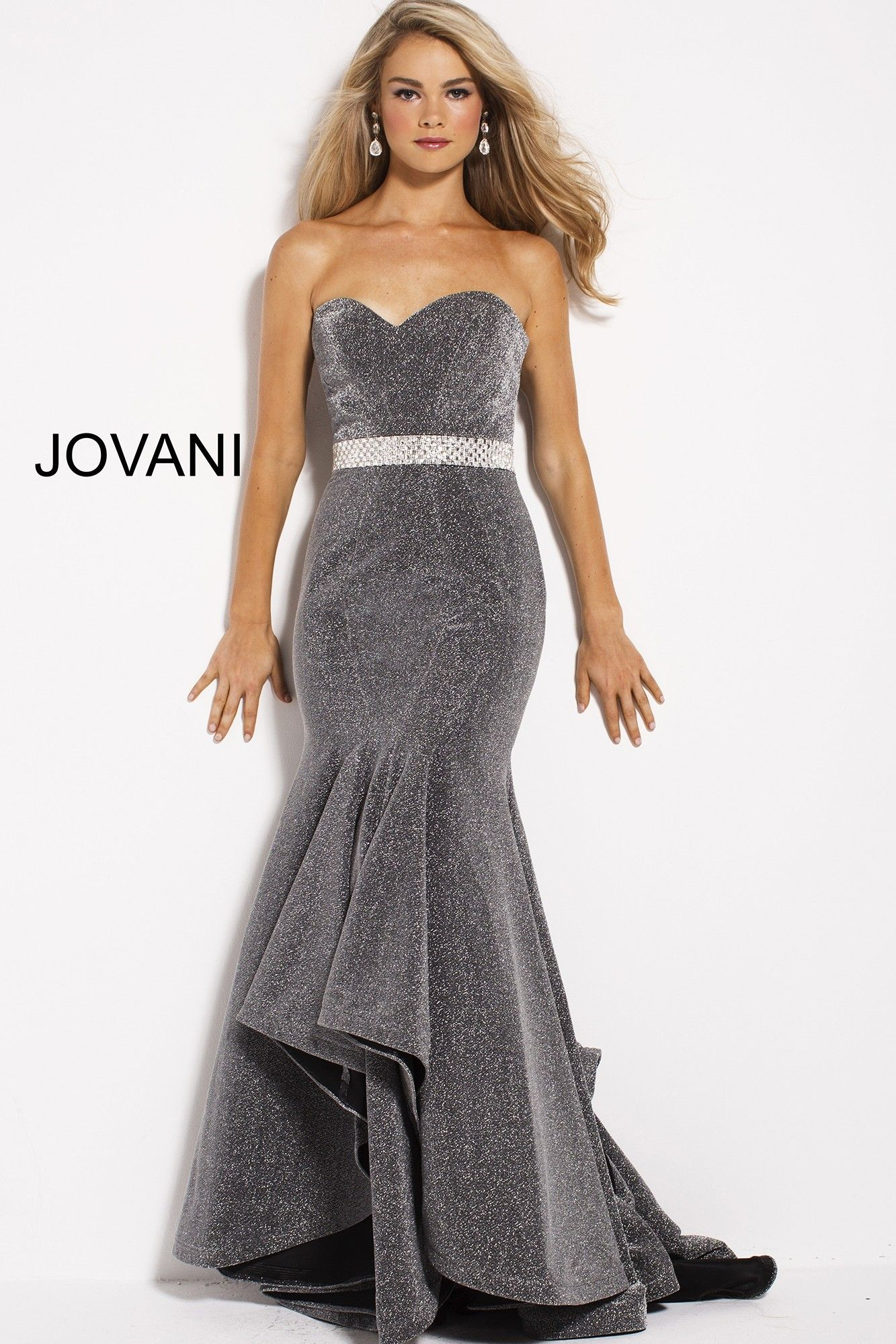 b449c0402f93 Shine like a Hollywood starlet in Jovani 56056. This glamorous glitter gown  shimmers from every angle. The strapless bodice has a sweetheart neckline,  ...