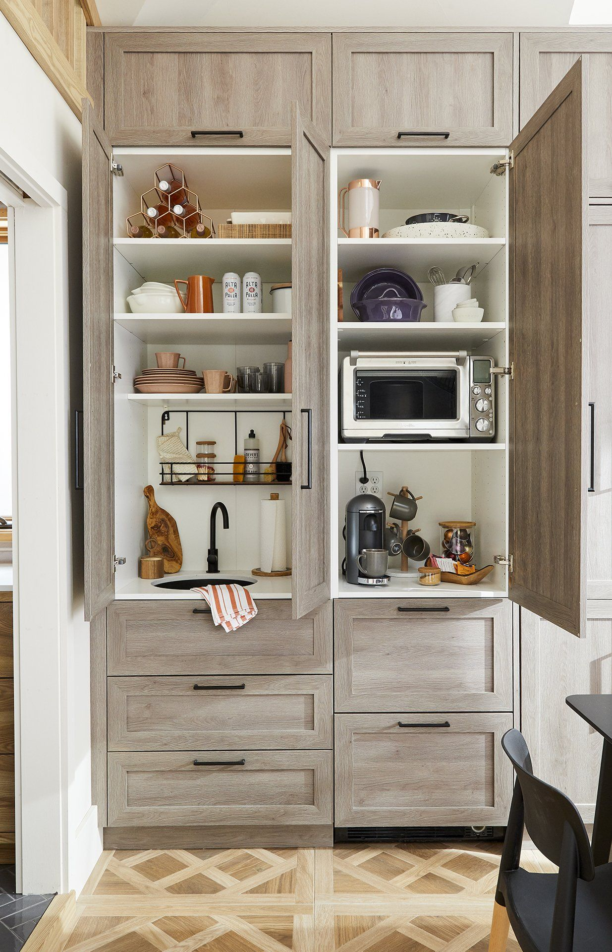 Clever Storage Wall Transforms This Unused Room Into A Heavenly Guest Retreat Clutter Free Kitchen Ikea Sektion Cabinets Appliance Garage