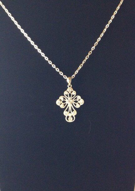 A personal favorite from my Etsy shop https://www.etsy.com/listing/281420264/vintage-large-silver-rhinestone-cross-on