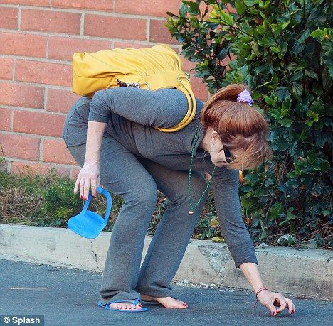 Frances Fisher bent to pick up a coin on the street