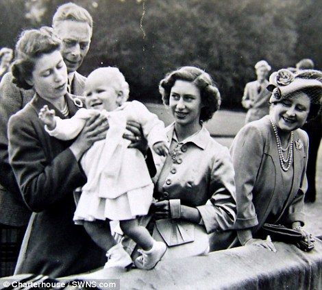 Hold On Dear Intimate Photos Of Royal Family In The 1950s Show A Young Prince Charles Sitting