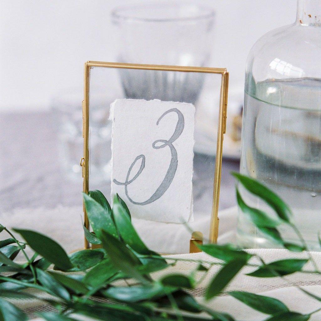 Goldener Glasrahmen   Glasrahmen, Tischdeko und Tischnummern