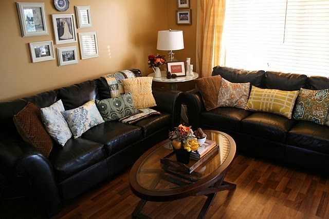 love  black leather couches    fun pillows