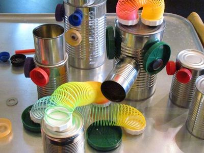 DIY magnetic robot building set using tin cans, bottle lids, and slinky!