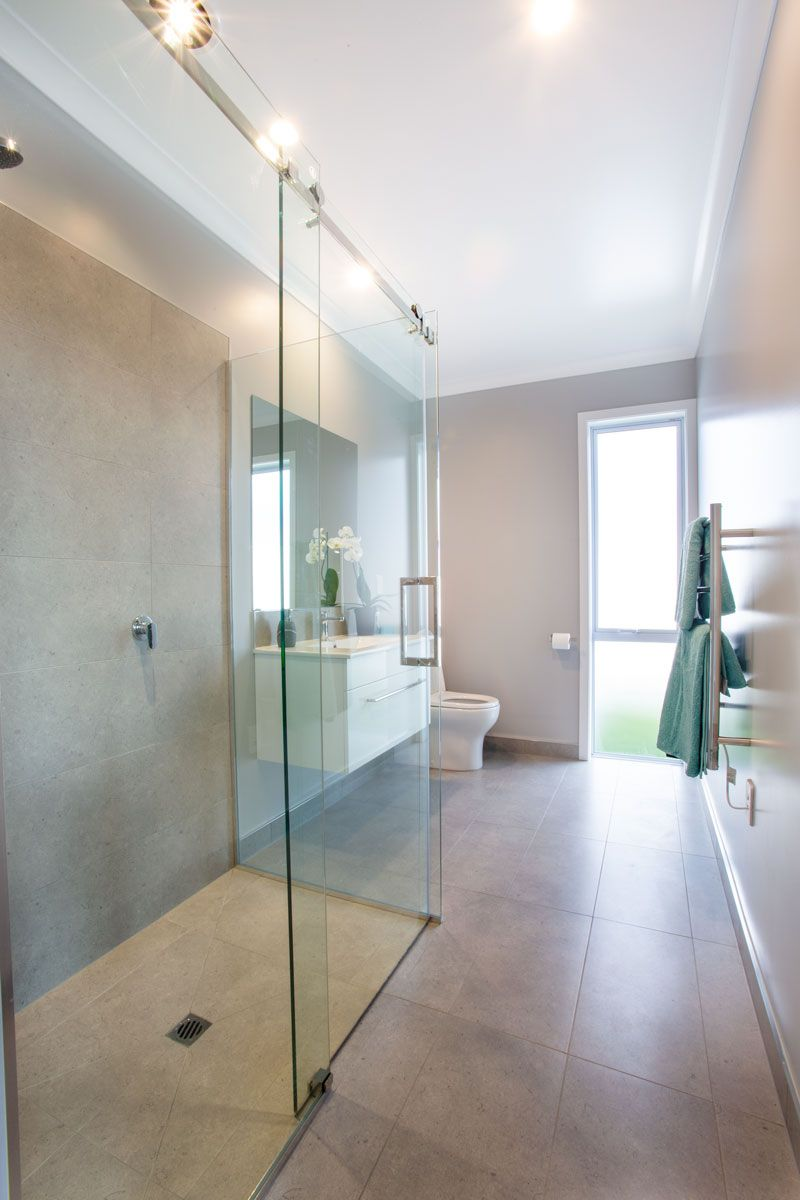 Modern And Contemporary Ensuite Featuring A Luxury Frameless Glass Sliding Shower Glassshower Sho Bedroom House Plans 4 Bedroom House 4 Bedroom House Plans
