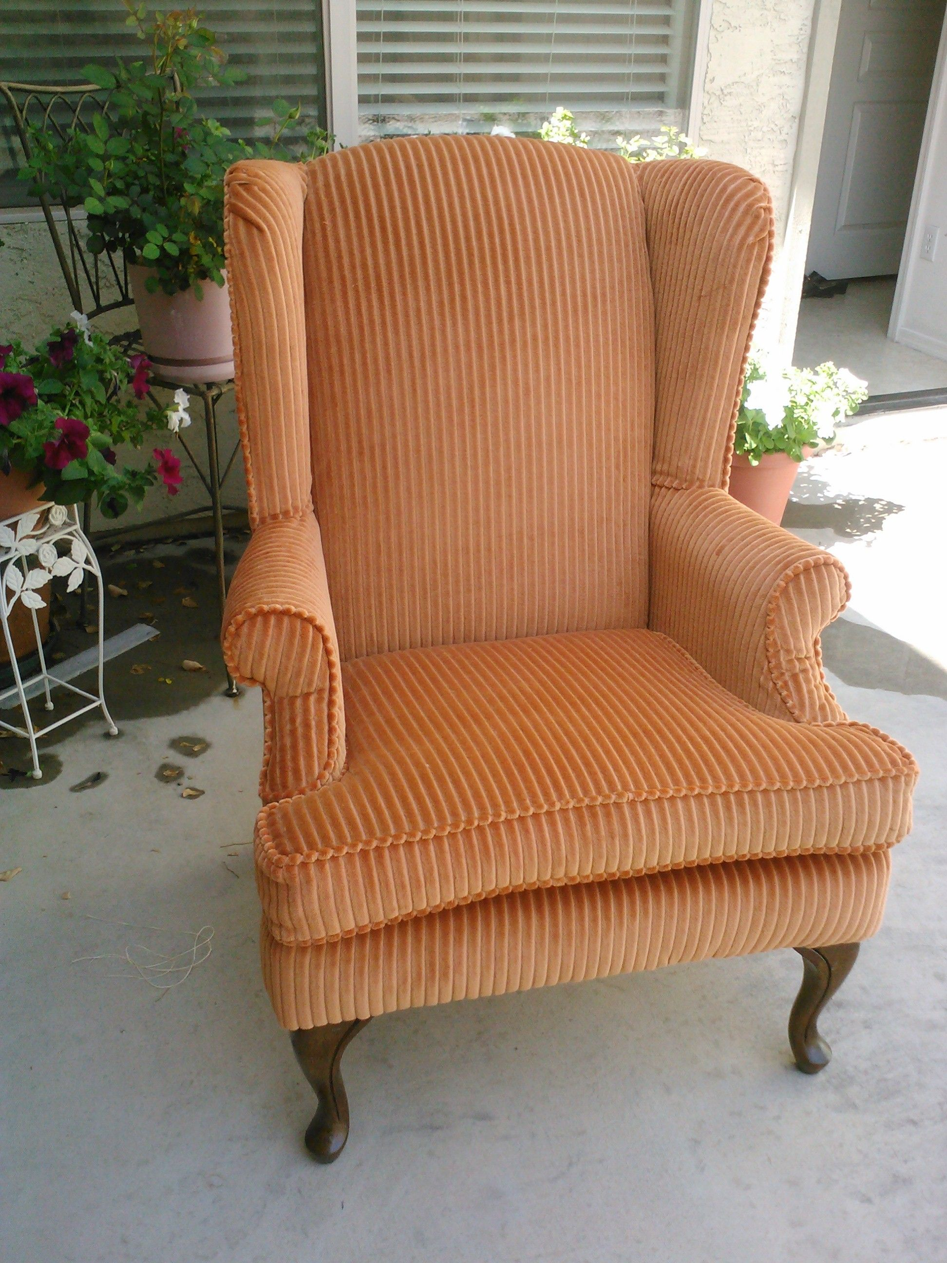 Wide Wale Orange Corduroy Fabric On Winged Back Chair.