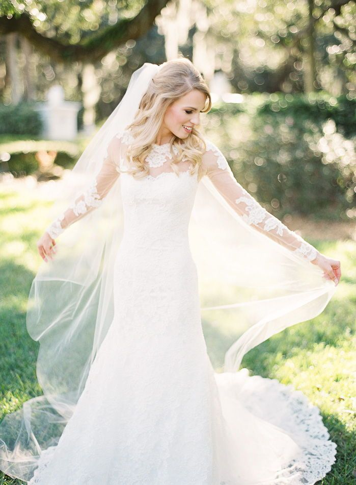 Outdoor bridal portrait pose ideas! Loved this sunny garden portrait of this gorgeous bride to be! The bright and classic photo is timeless. Love her long veil, big smile, classic wedding gown, and big loose blonde curls for a wedding day hair half up half down. | Strapless, fitted, lace, fit and flare, winter, spring, summer, fall, wedding flowers, 2020 wedding, 2019 wedding, DIY, Tampa Florida photographers, easy wedding, simple, vintage, romantic, wedding dress ideas, simple wedding dress, la #bridalportraitposes