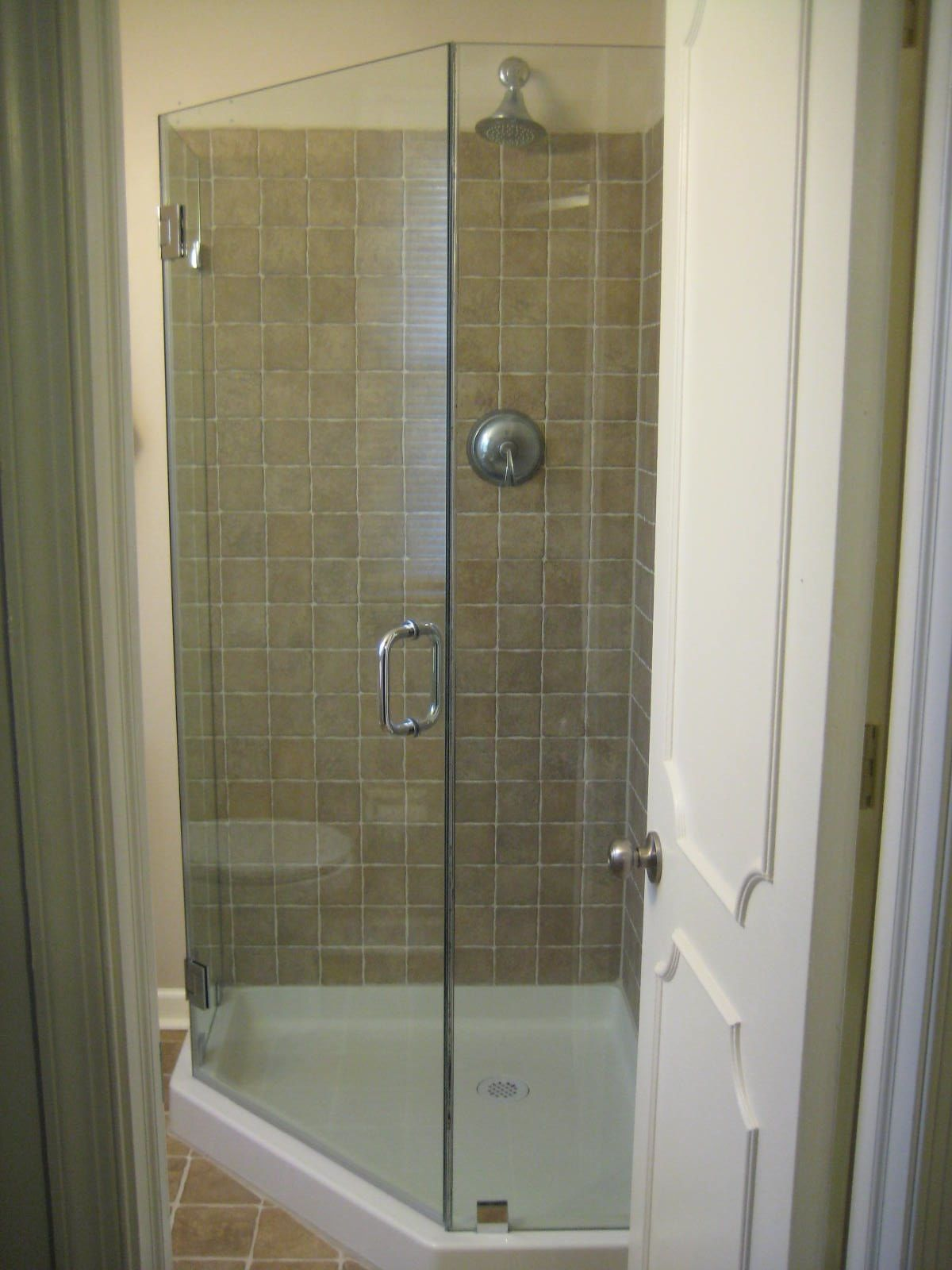 Frameless neo-angle shower enclosure, shown with a 36x36\