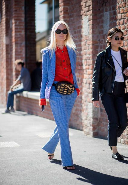 15c6fd5b0e5 Thora Valdimars wearing Gucci belt bag red cardigan blue suit is seen  outside Gucci during Milan Fashion Week Spring Summer 2018 on September 20  2017.