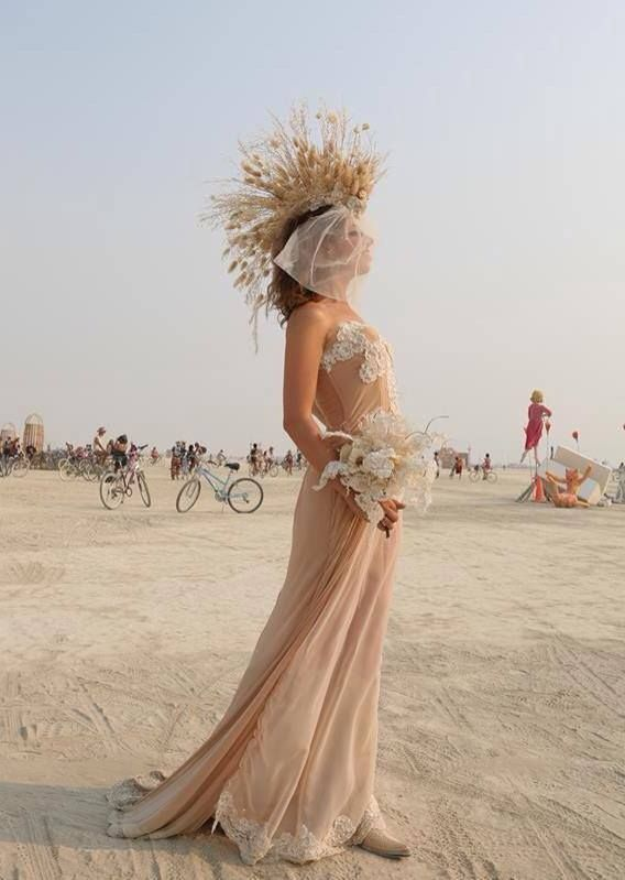 Playa weddings make the concept of a wedding sound more appealing. I couldn't find the source for this image, so please let me know if you know who shot it.