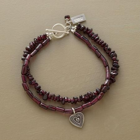 """DOUBLE GARNET BRACELET - Garnets two ways: one strand of chips, another of cylinder beads. The latter dangles a sterling silver heart charm. Toggle clasp. Ours exclusively, handcrafted in USA. Approx. 7-1/2""""L."""