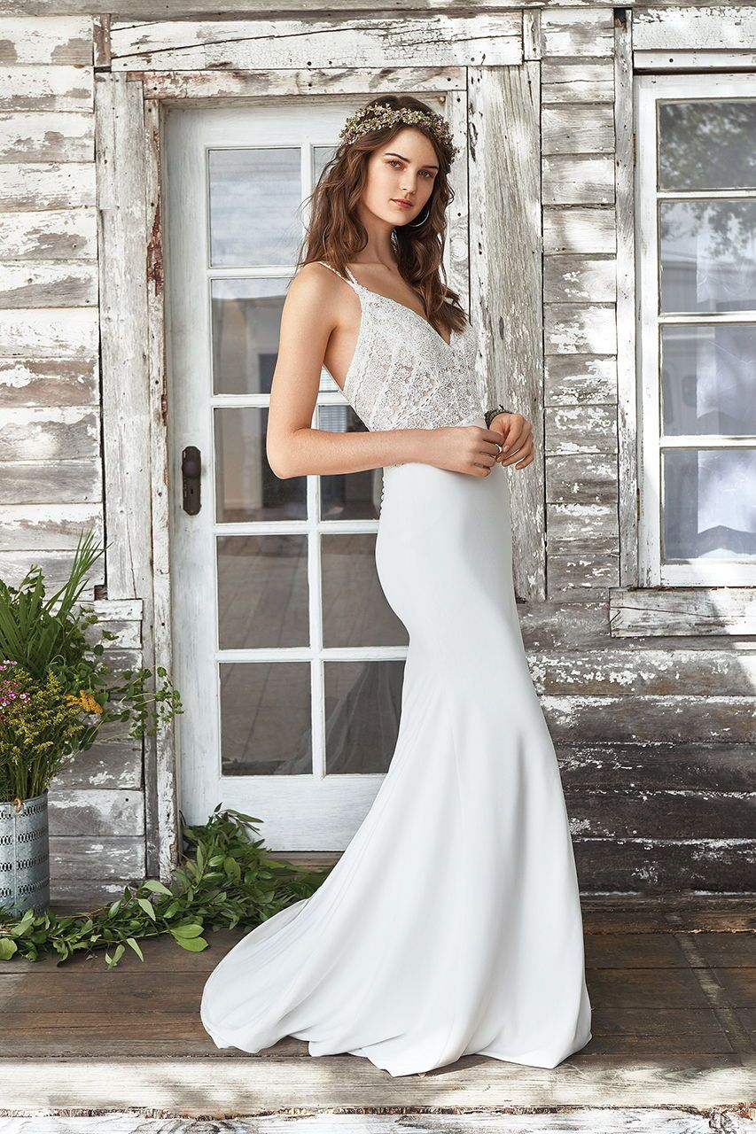 a81cbdcc54 Lillian West fit-and-flare wedding gow with a lace bodice.