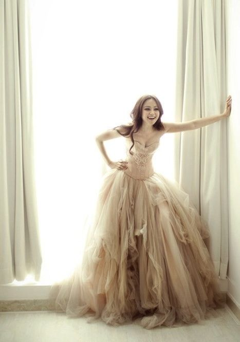 So yeah, I want a cream colored wedding dress