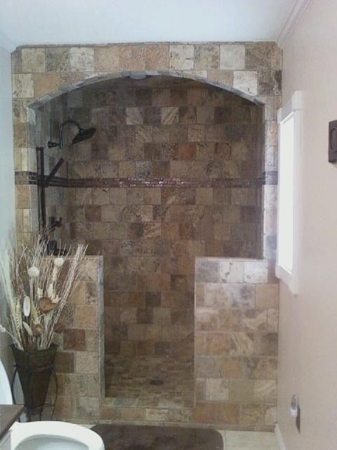 Scabos Natural Stone Arched Entry Shower With Bronze Deco