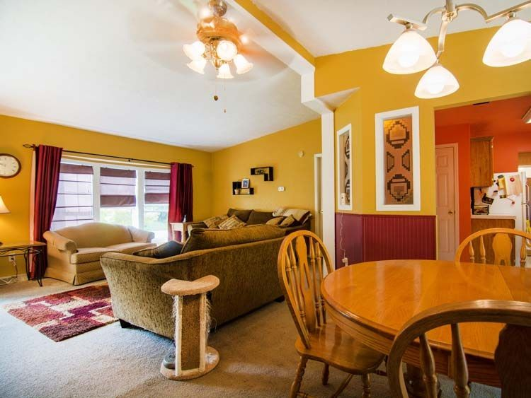 Charmant Mustard Colored Walls With Burgundy Trim In Living Room And Dining Room.