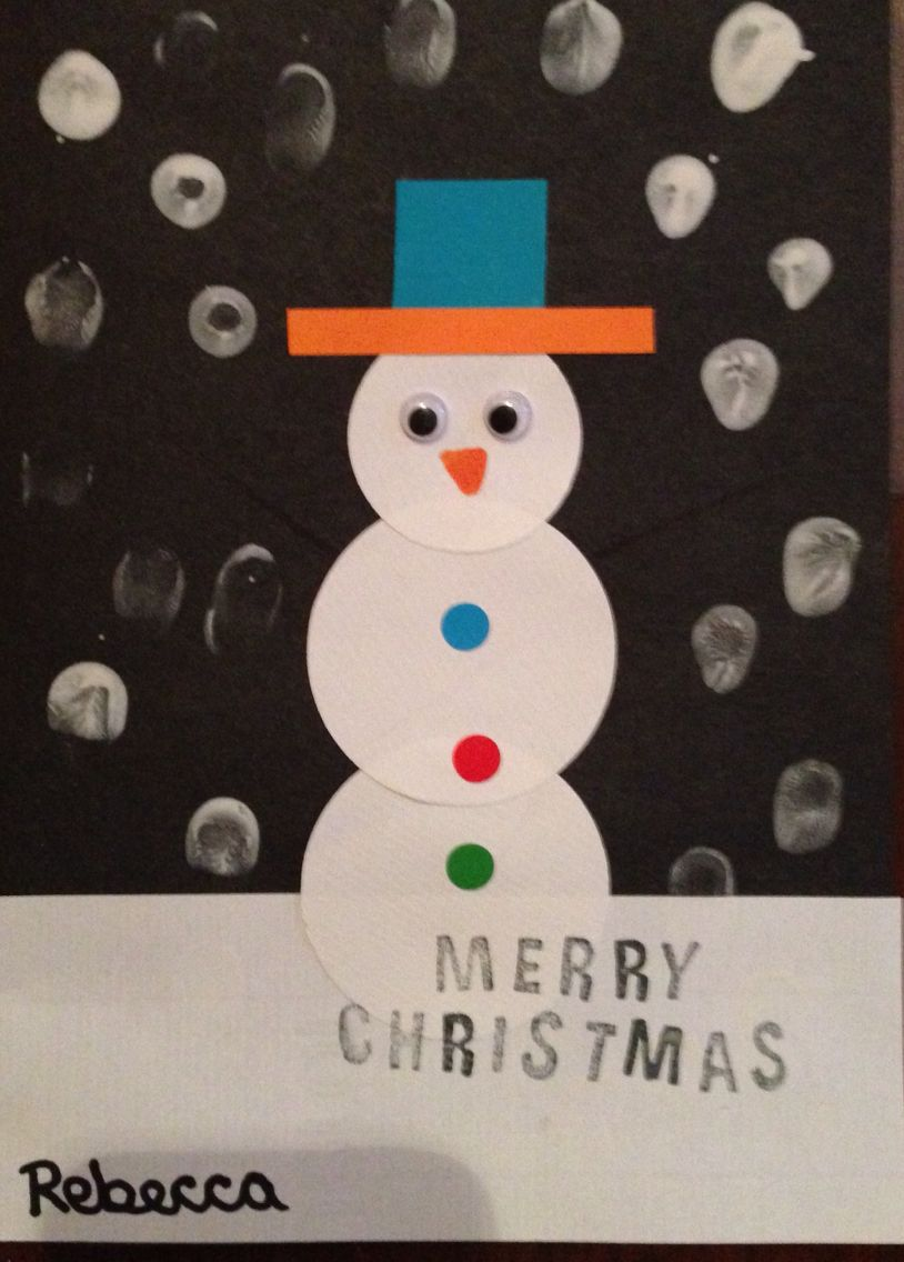 Snowman Christmas card. Made from white paper circles, small pieces of coloured paper, goggly eyes, coloured dot stickers and white finger painted snow.
