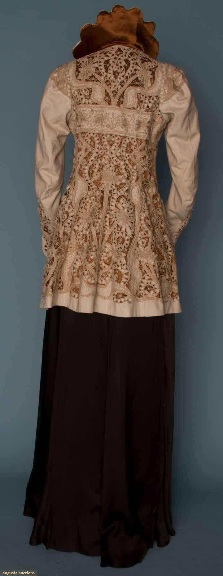 EMBROIDERED WHITE WOOL JACKET, c. 1908. Empire w/ cutwork & embroidery in serpentine & floral pattern, lavishly embroidered flowers, scalloped collar, cocoa brown silk lining. Back