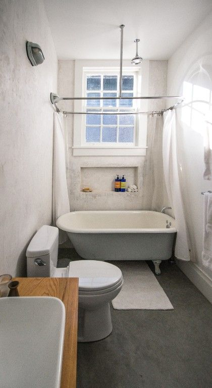 Oversized rain shower head above a claw foot tub for Clawfoot tub and shower combo