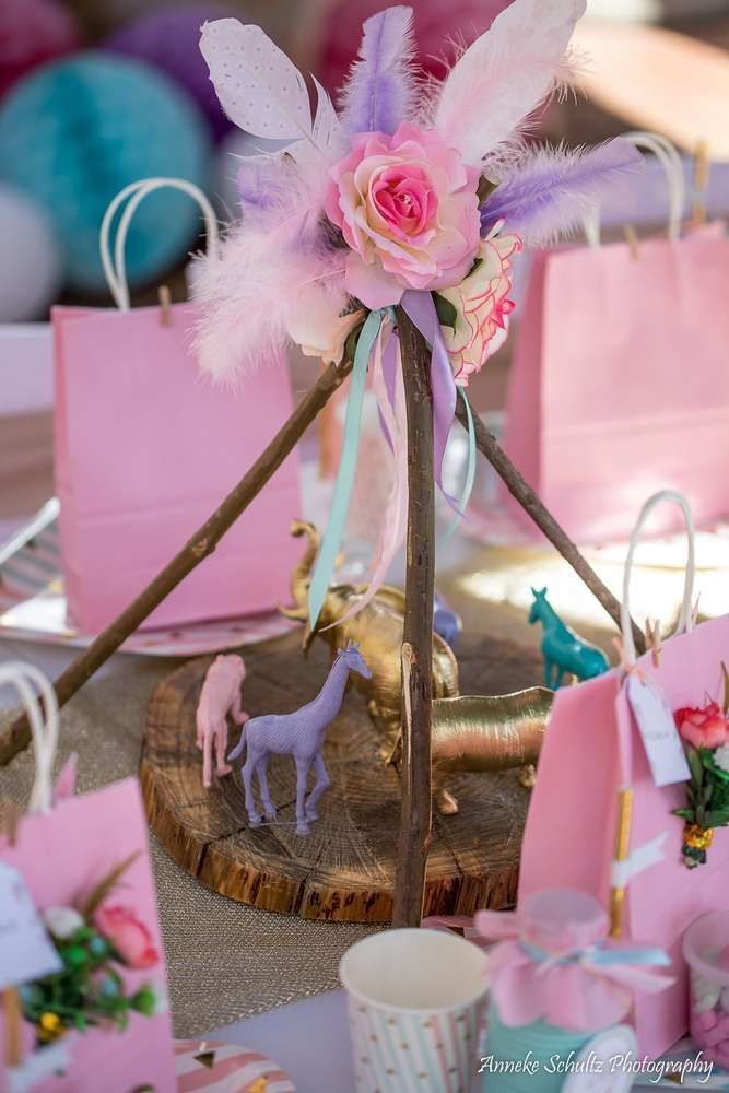 The boho decor at this Wild one 1st Birthday Party is gorgeous!!  See more party ideas and share yours at CatchMyParty.com #catchmyparty  #partyideas #wildone bohobirthdayparty #girl1stbirthdayparty #africa #partydecorations #tablesettings #animals