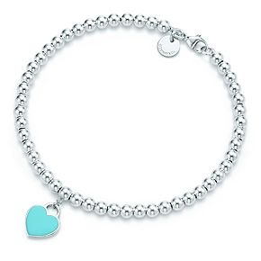Return to Tiffany™ mini heart tag in sterling silver on a bead bracelet