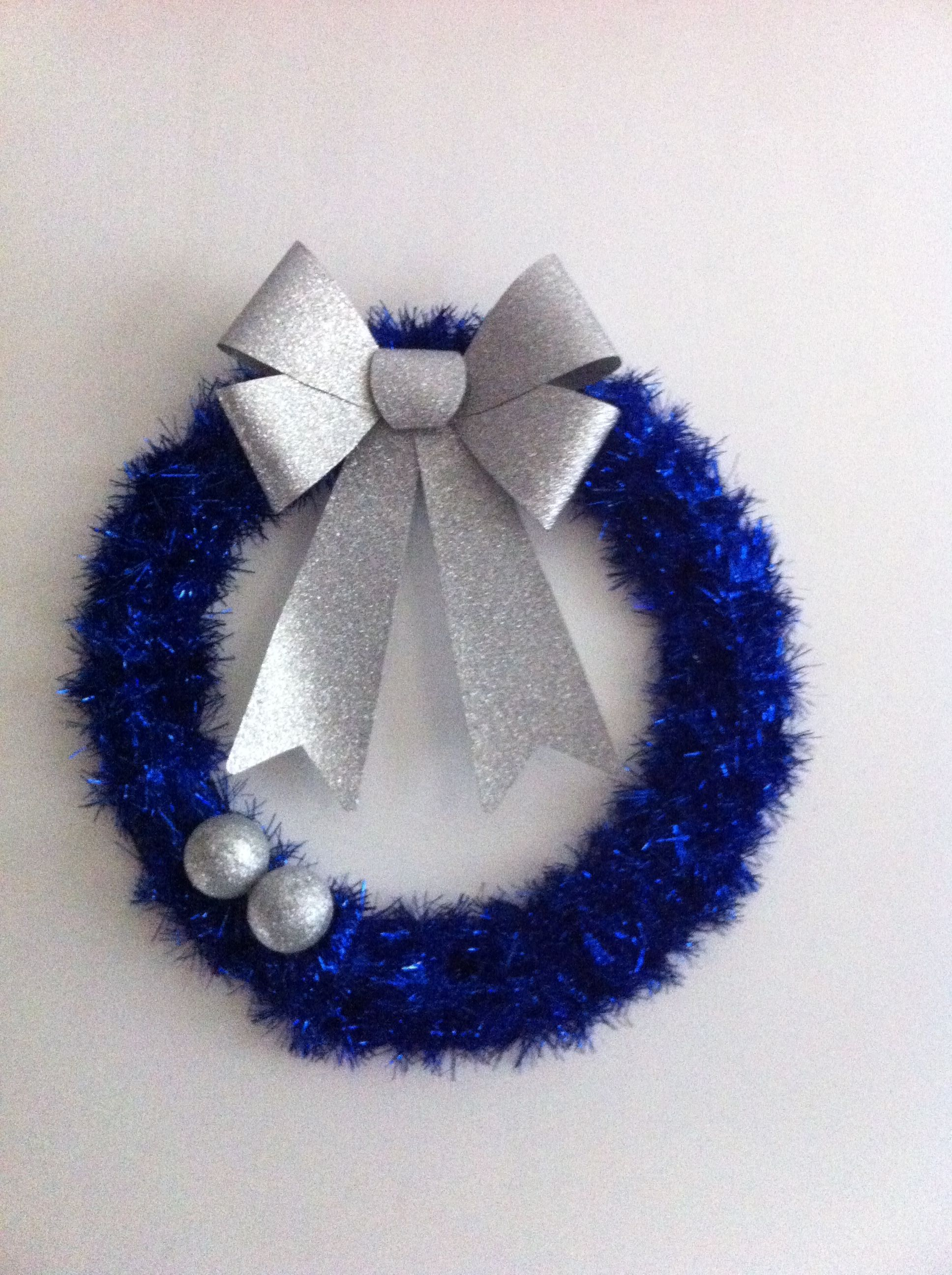 Tinsel wreath with a few ornaments. Leftover ornaments n