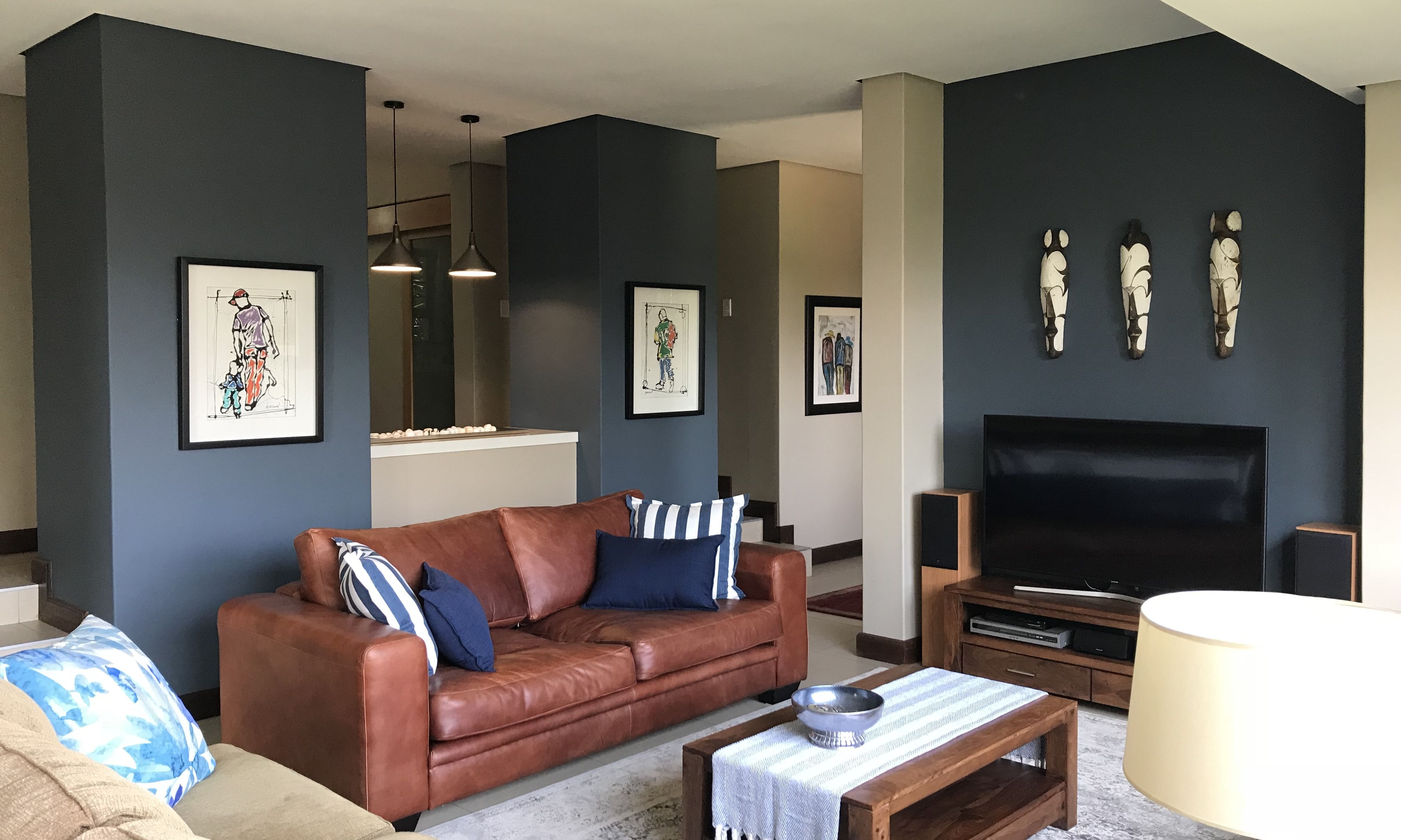 Living Room With Tan Leather Couch And Indigo Blue Walls Tan Leather Couch Tan Leather Sofas Leather Couch