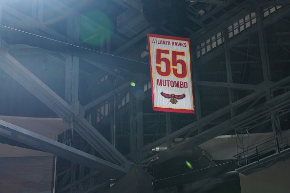 The Atlanta Hawks former player Dikembe Mutombo jersey is retired during the game against the Boston Celtics on November 24 2015 at Philips Arena in...