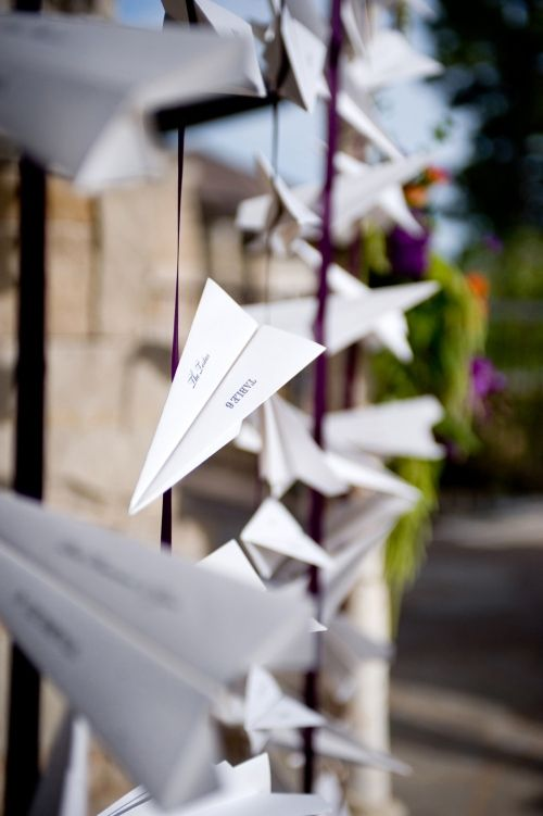 Paper planes attached to ribbons