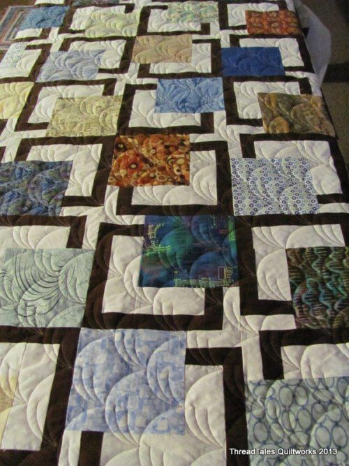 Nice modern quilt design, and I love the quilting pattern, too, from Threadtales blog