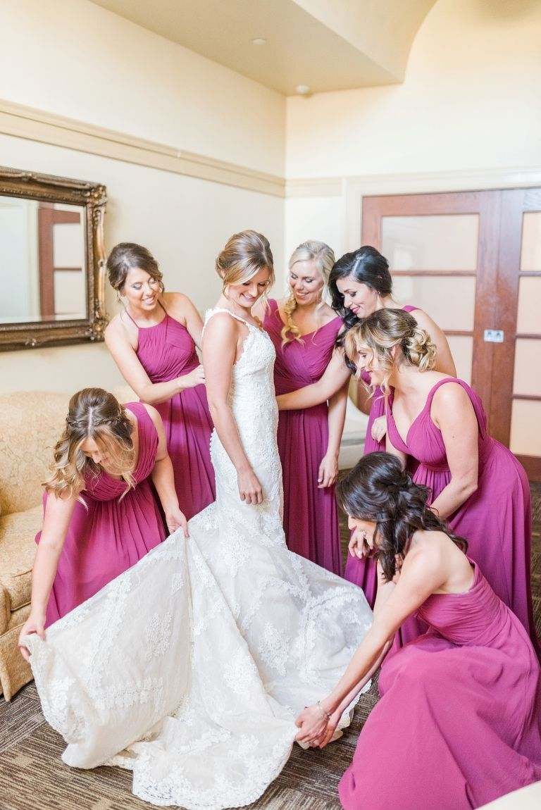 Bridal getting ready photo with bridesmaids fluffing the dress bridal getting ready photo with bridesmaids fluffing the dress azazie bridesmaid dresses ombrellifo Gallery