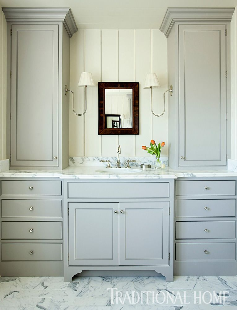 Contemporary Art Sites In the master bath pale gray vanity cabinetry with furniture style legs is paired with the Calacatta Gold marble counters and floor for a stunning effect