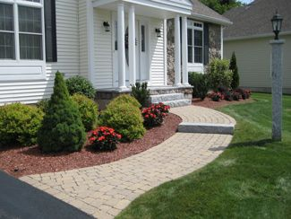 Curved retaining wall ideas pelham nh landscaping for Curved garden wall ideas