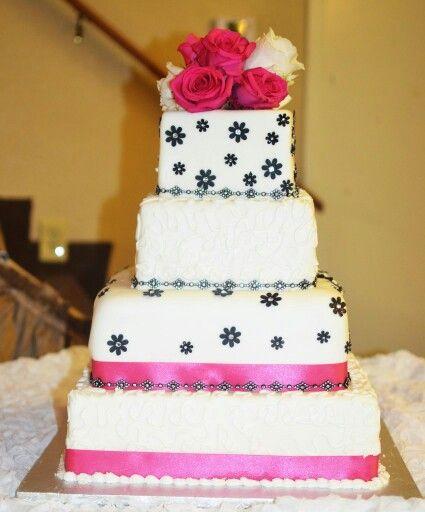Pink, black and white wedding cake