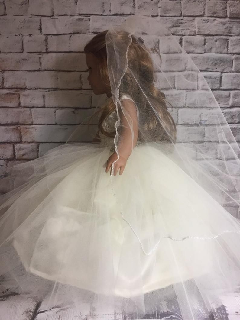 A Fantasy Ivory Wedding Gown with Veil and Bouquet Made to Fit the Barbie Doll