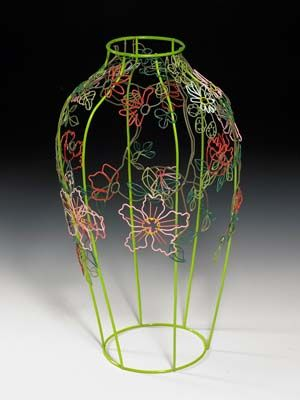 Cathy Miles Green vase A iron wire vase, powder coated and hand painted with enamel.