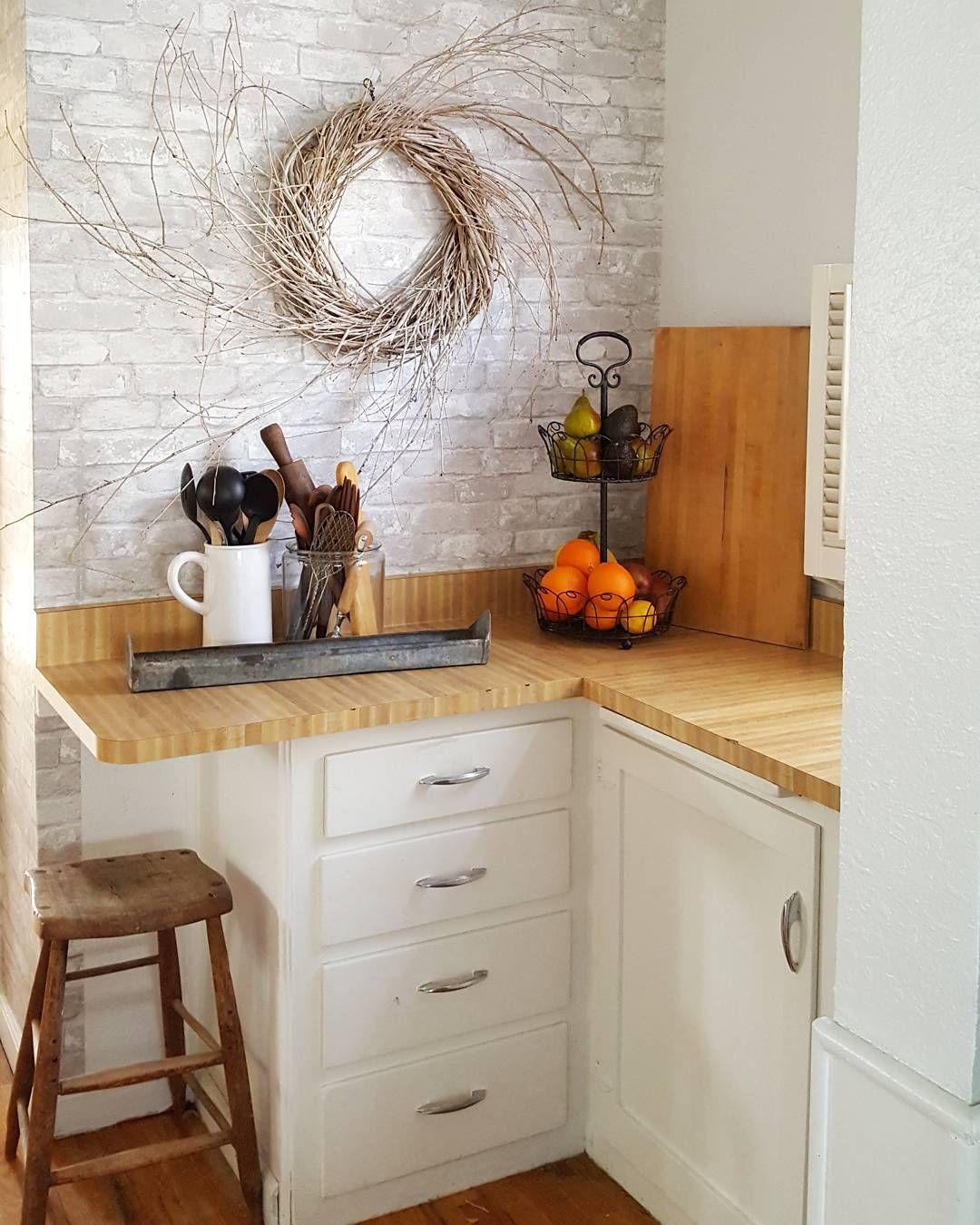 Grey brick peel and stick wallpaper in a kitchen Kitchen